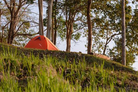 Orange tent campsite with beautiful scene.