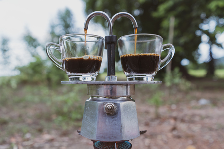 Making double shots coffee with moka pot.