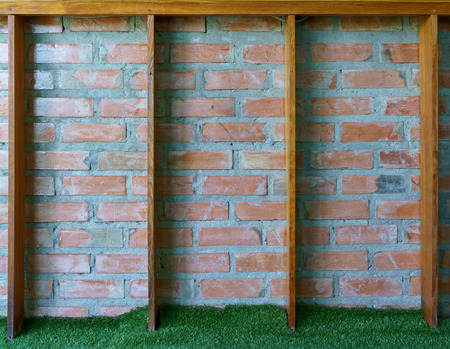 Grunge vintage brick wall with wooden frame.