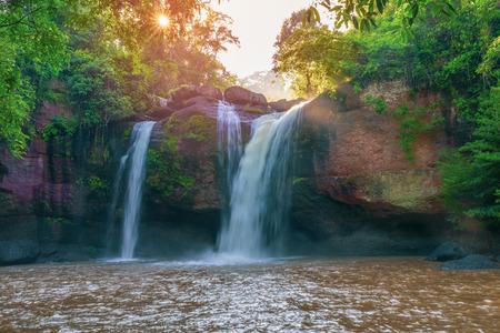 Beautiful waterfall with sunlight in jungle, Haew Suwat Waterfall.