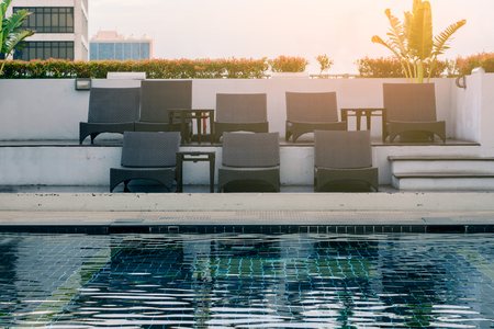 Luxury chairs at swimming pool side.