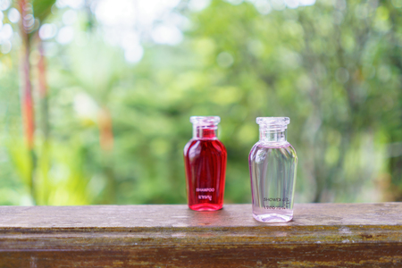 Shower gel bottle place on table with nature background.