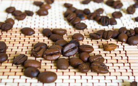 Fresh coffe beans background. Macro photo