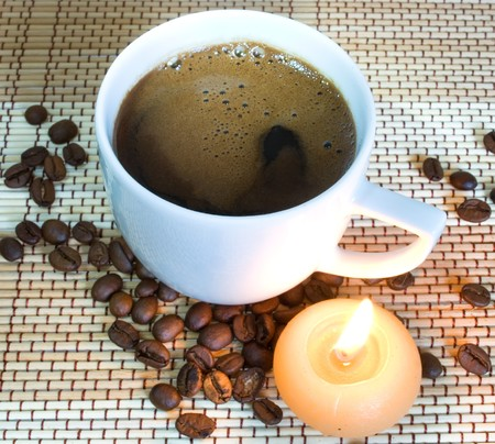 Cup of coffe with candle photo