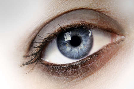 Womans blue eye close up photo