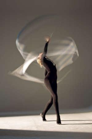 action blur: Rhythmic gymnast performing