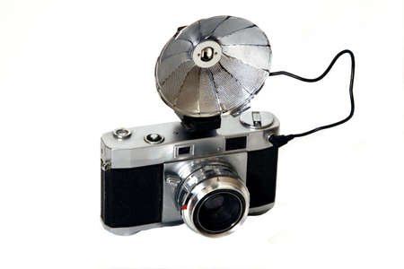 Old camera and flash on a white background.