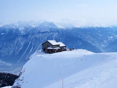 An isolated cafe building on the piste in the Swiss Alps.