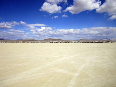 A large camping ground in the dry desert.