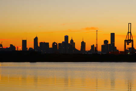 Looking at Melbourne docks and city across the bay early in the morning. Stock Photo