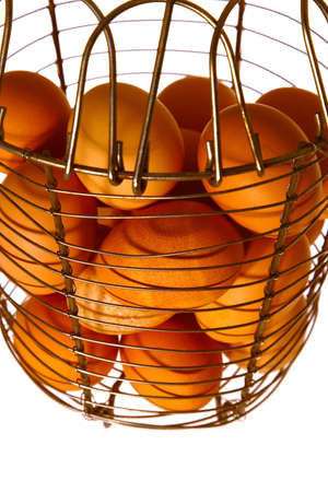 An old fashioned metal basket full of fresh eggs. Stock Photo