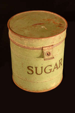 An old sugar can on a black background. Stock Photo