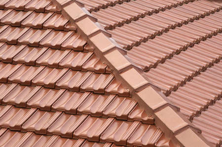 The corner section of a new tiled roof. Stock Photo