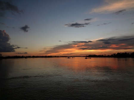 Looking across the Mekong River Delta in Laos at sunset.