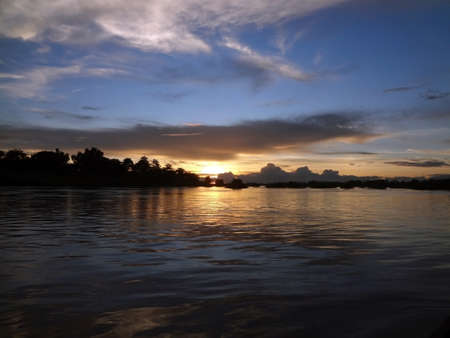 Storm over the Mekong River Delta with cloudscape in Laos at sunset.