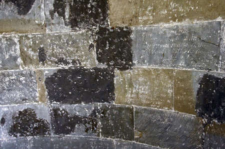 An grey old stone wall texture which is curved slightly  photo