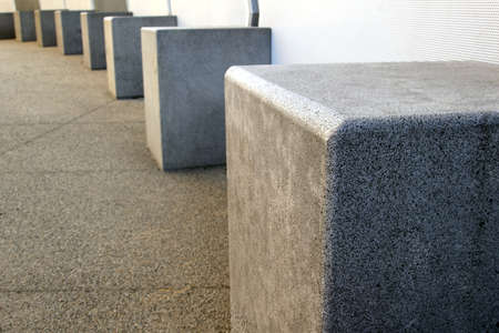 A row of concrete blocks in the city.