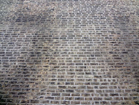 A weathered brick wall texture or background.                                Stock Photo