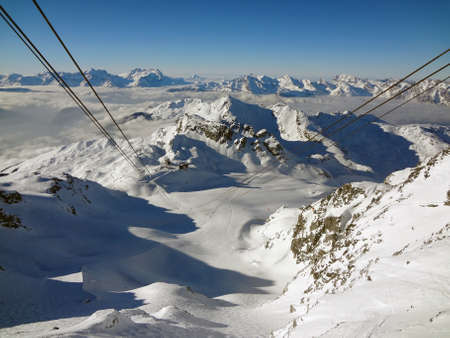 Looking down the cable car wire from the top of Mont Fort in Switzerland