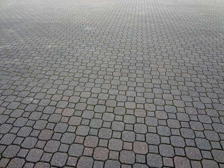 A large patterned brick paving textured background                                 Stock Photo