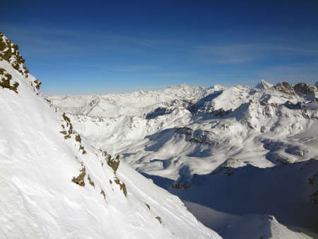 A steep snow face with majestic Swiss alps in the background                                 Stock Photo