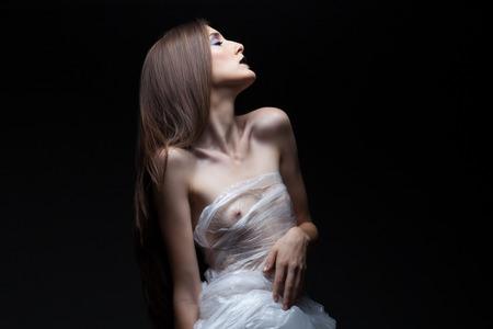 semi nude: art portrait of beautiful semi nude young woman in studio