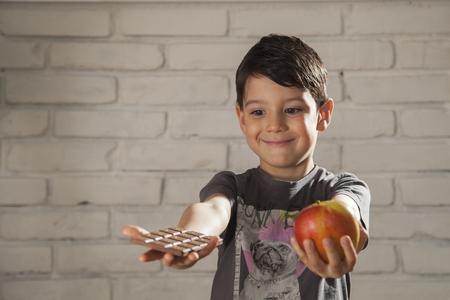 alergy: child chooses chocolate or apple 02