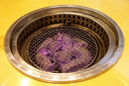 grill: Traditional charcoal stove in Japanese restaurant.