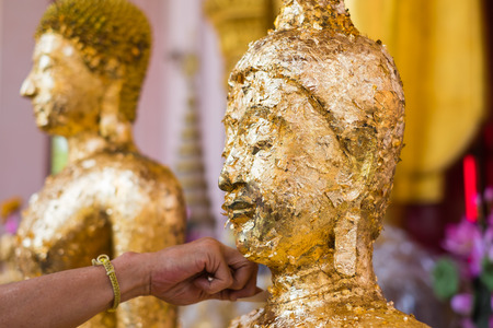 nakhon pathom: Golden Buddha statue were gilded at Wat Phra Pathom Chedi in Nakhon Pathom Thailand. Stock Photo