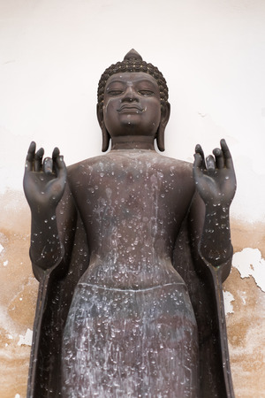 nakhon pathom: Old Buddha statue at Wat Phra Pathom Chedi in Nakhon Pathom Thailand. Stock Photo
