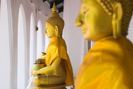 nakhon pathom: Golden Buddha statue at Wat Phra Pathom Chedi in Nakhon Pathom, Thailand.