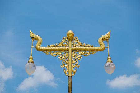 nakhon pathom: Nagas lantern in gold color at Wat Phra Pathom Chedi in Nakhon Pathom, Thailand.