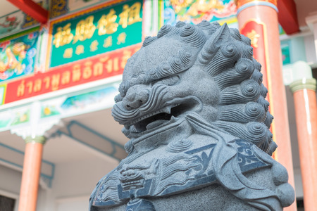 face guard: Chinese lion statue the guardian of the gate.