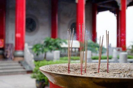 buddhism prayer belief: Incense sticks in the incense burner at the temple. Stock Photo