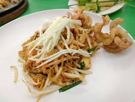 rind: Thai fried noodles called Pad Thai with cashew nut and pork rind.