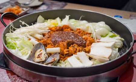 a traditional korean: Dak Galbi, a traditional Korean cuisine, stir-fried meat and seafood with yakisoba noodle and japanese rice in spicy sauce. Stock Photo
