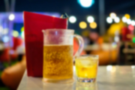 beer bucket: Abstract blur of draft beer and ice bucket on the table in a restaurant for background. Stock Photo