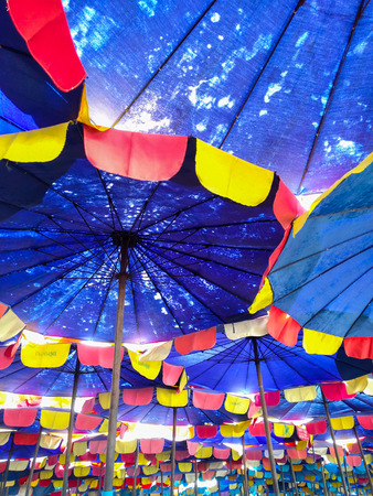 Bottom view of beach umbrella at Bangsan beach, Chonburi, Thailand. Stock Photo