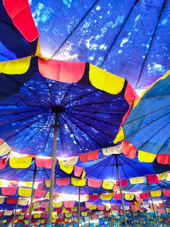 polychromatic: Bottom view of beach umbrella at Bangsan beach, Chonburi, Thailand. Stock Photo