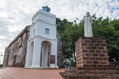 Statue of St. Francis Xavier in front of the ruins of St. Pauls Church in Malacca, Malaysia.