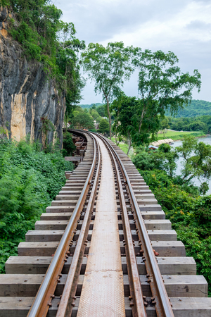 The Death Railway on the cliff with Khwae Noi River located at Kanchanaburi, Thailand.