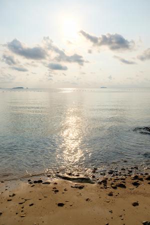 Beach with tranquil seascape during sunrise in dawn at Ao Lung Dam beach in Samet island, Thailand.