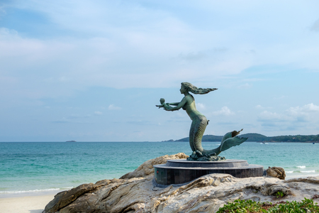The mermaid statue with seascape background at Sai Kaew beach in Samet island, Rayong Province, Thailand.