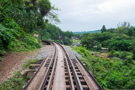 hill station tree: The Death Railway bridge at Krasae Cave in Kanchanaburi, Thailand.