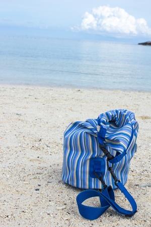 Blue bag on the beach