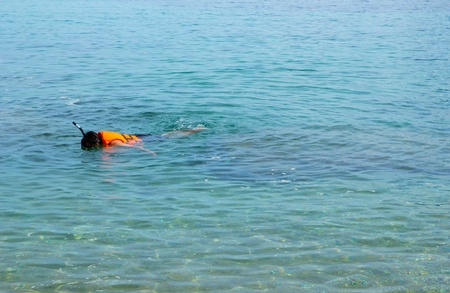 Man with life jacket to snorkeling in sea