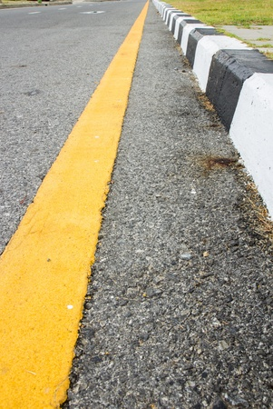 Perspective yellow line and footpath Stock Photo