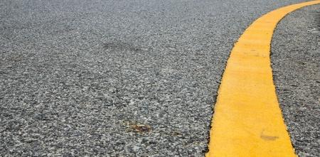 Curve yellow line on street Stock Photo