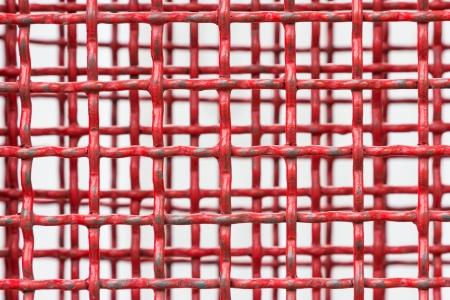 netty: Antecedentes de rejilla de acero rojo Foto de archivo