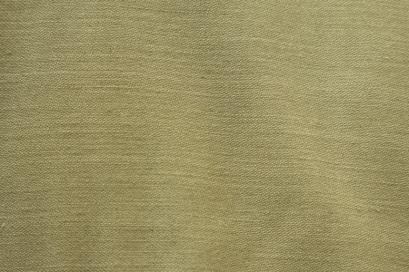 Fabric background of green closeup